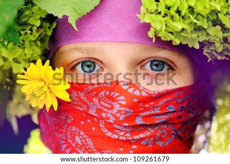 Girl with a scarf on face,