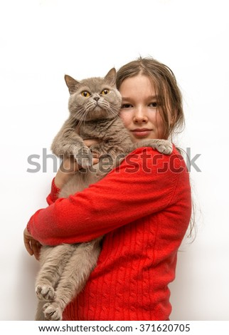 Girl with a scottish cat in her arms on a white background - stock photo