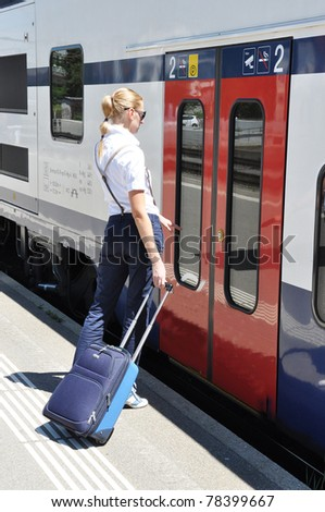 Girl with a suitcase at the train - stock photo