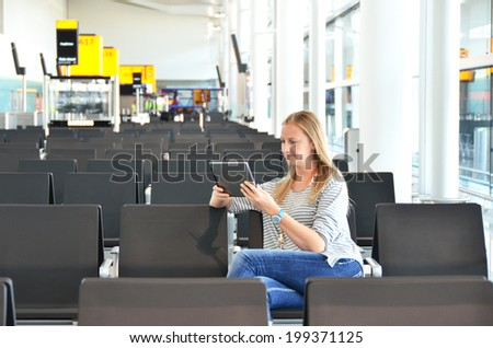 Girl with a tablet in the airport - stock photo