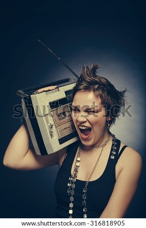 Girl with a tape recorder - stock photo