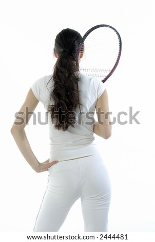 Girl with a tennis racket - stock photo