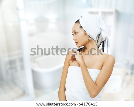 girl with a towel in the bathroom - stock photo