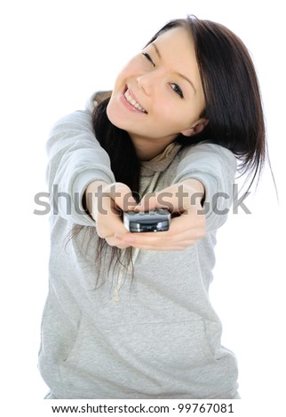 Girl with a tv or other electronic remote control. - stock photo