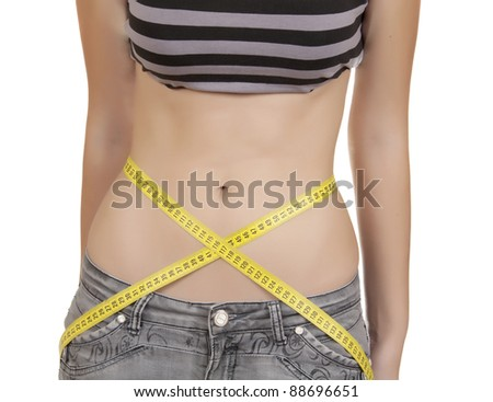 girl with a waist measuring tape on white background