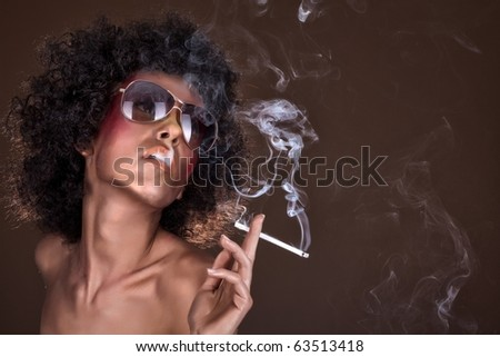 girl with afro hair and a cigarette - stock photo