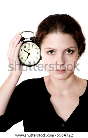 girl with an alarm clock in a hand.