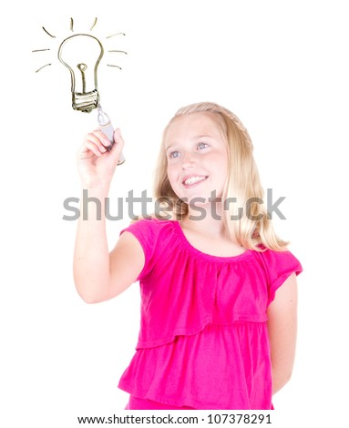 girl with an idea drawing light bulb with marker, isolated on white - stock photo