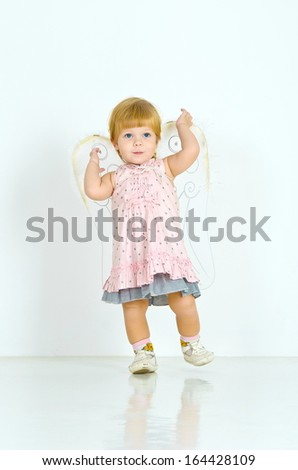 girl with angel wings on a white background in full length
