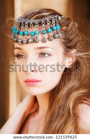 Girl with antique jewelry - stock photo