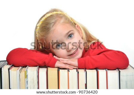girl with arms crossed on books - stock photo