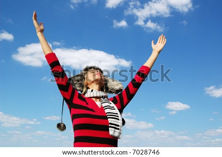 Girl with arms wide open in attitude of worship - stock photo