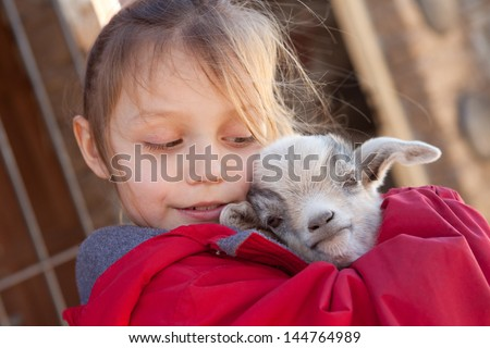 girl with baby goat - stock photo