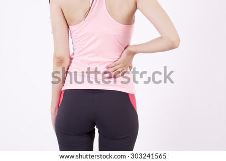 girl with back pain - stock photo