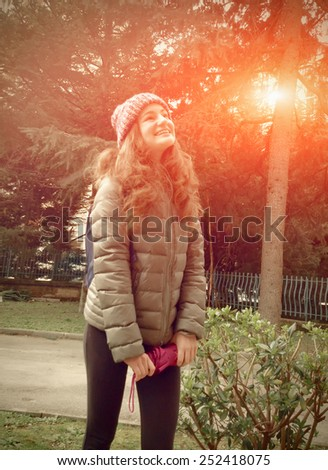 girl with backpack and winter hat - mobile photo