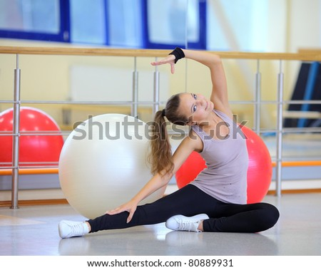 Girl with ball in gym