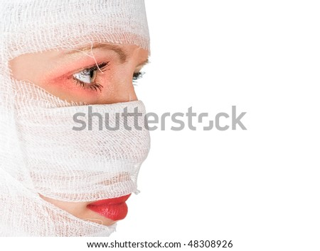 girl with bandages on her face on white