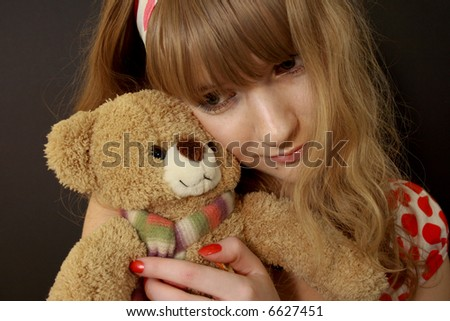 Girl with bear toy