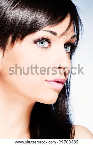 girl with beautiful blue eyes portrait studio shot - stock photo