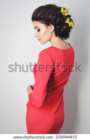 girl with beautiful hair in evening dress with flowers in her hair