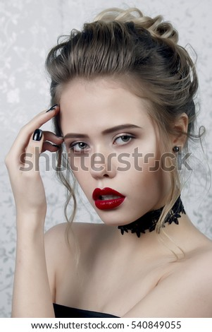 girl with beautiful make-up with red lips and hair checker on the neck