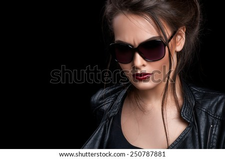 Girl with beautiful makeup. Portrait of a girl. Girl in leather jacket .Makiyazh smoke eyes. The girl in glasses.