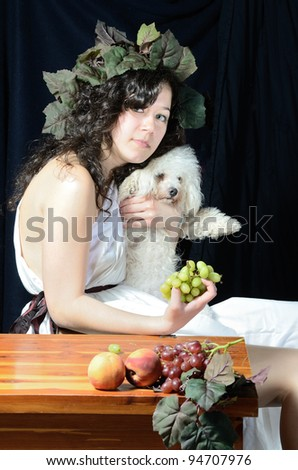 Girl with bichon frise in classical attire - stock photo