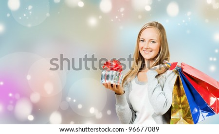 Girl with big shopping bags - stock photo