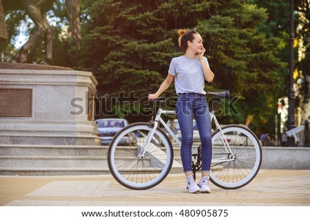 girl with bike fix on the phone. Concept health sport