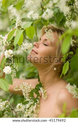 Girl with bird cherry flowers - very cute portrait - stock photo