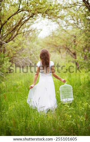 Girl with birdcage - stock photo