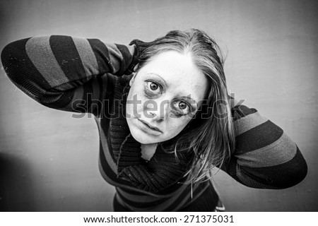 Girl with black eyes nervous and sick - stock photo