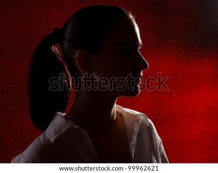 girl with black long hair in backlight