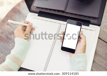 Girl with blank cell phone and diary, mock up - stock photo