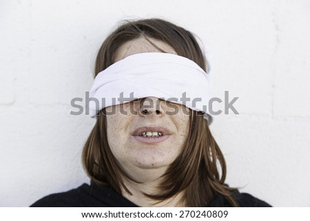 Girl with blindfold, sadness and fear - stock photo