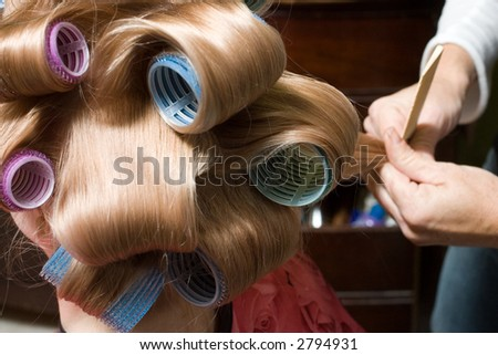 Girl with Blond Hair in rollers - stock photo
