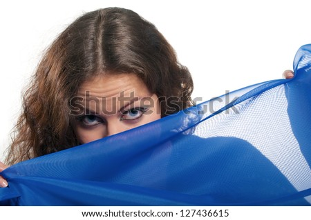 curly hairs looks over blue veil on white background - stock photo
