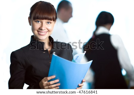 Girl with blue folder and men and women