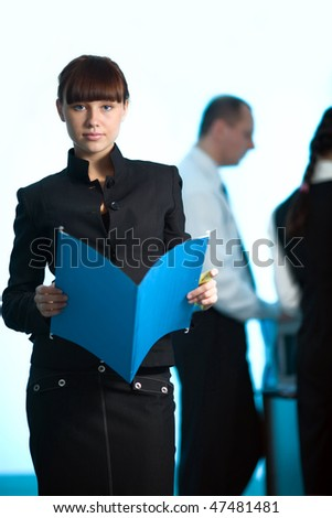 Girl with blue folder and men with women - stock photo
