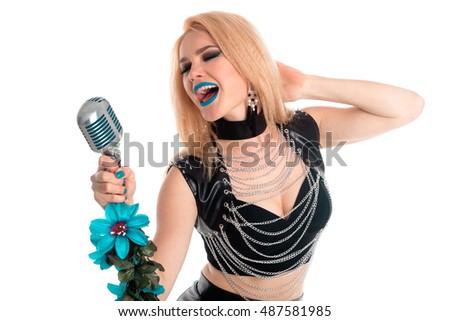 Girl with blue lips is singing to the microphone and touching her hair