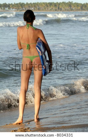 Girl with boogie board by sunset