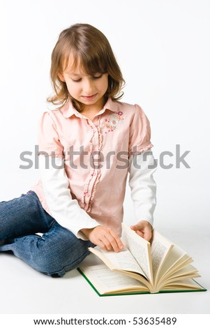 Girl with book sitting on the floor
