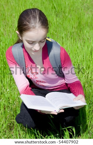 Girl with book. Studying on nature.