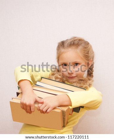 Girl with books - stock photo