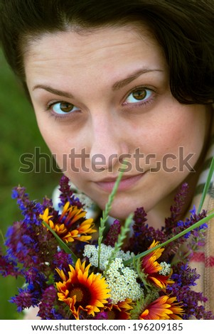 girl with  bouquet of  salvia and camomile