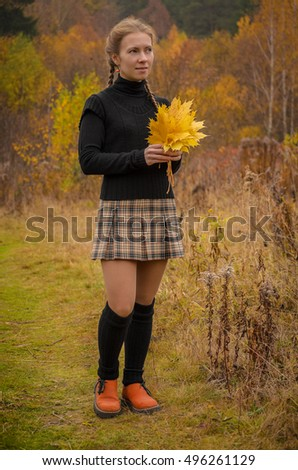girl with braids in the autumn forest