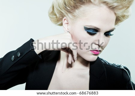 girl with bright makeup in front of the jacket