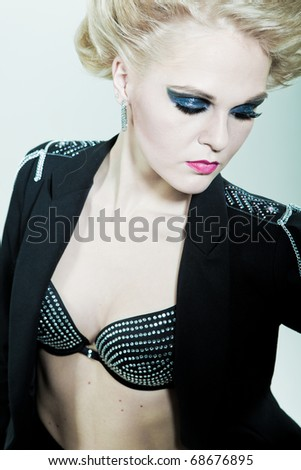 girl with bright makeup on eyes and lips - stock photo
