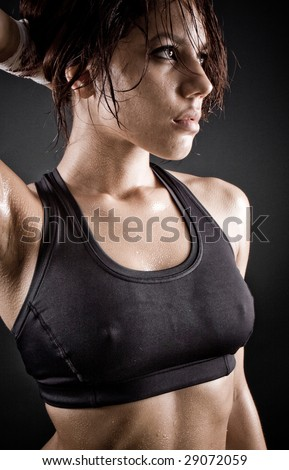 girl with brown hair sweating after workout - stock photo