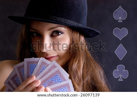 Girl with cards and in a black hat.